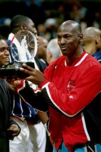 Michael Jordan wearing the jacket while he receives the 1996 All Star MVP award