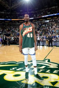 Kevin Durant received an ovation in his comeback to Seattle during a Golden State Warriors preseason game in 2018. KD paid tribute to Shawn Kemp wearing his jersey