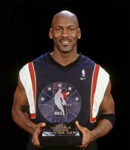 Michael Jordan with the 1998 NBA All Star MVP trophy