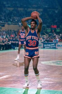"""Bernard King in action with the jersey. In 1984 King became the first player since Rick Barry in 1967 to score at least 50 points in two consecutive games. He scored 50 points in San Antonio and Dallas and his performance made history as """"The Texas Massacre"""""""