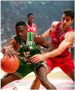 """""""Rambo"""" wearing a similar jersey while he is defending Dominique Wilkins"""